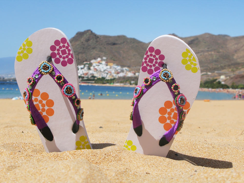 flip-flops-in-sand_shutterstock_59813551